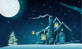 Christmas night with a fabulous house and a Christmas tree Stock Photography