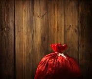 Christmas Santa Claus Red Bag Full, Xmas Wood, Wooden Plank Wall Royalty Free Stock Images