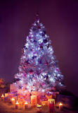 Christmas Tree Lights, Decorated Xmas Tree, Presents Candles Stock Images