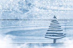 Christmas tree made from dry sticks on wooden, blue background. Snow and snow flaks image. Christmas tree ornament with star. Stock Images