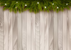 Christmas wooden background with branches and baubles. Royalty Free Stock Images