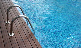Chrome ladder into swimming pool Royalty Free Stock Photography