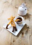 Churros mit heißer Schokolade Stockfotografie