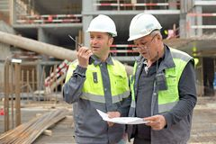 Civil Engineer and Senior Foreman At Construction Site Royalty Free Stock Images