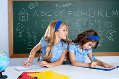 Classroom with two kids students cheating on test Royalty Free Stock Photography