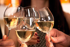 Clicking glasses with white wine. Royalty Free Stock Images