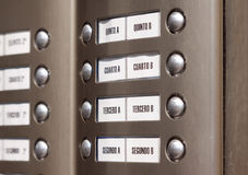 Building intercom. Apartment numbers in Spanish Royalty Free Stock Photography