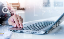 Close up of business man typing on laptop computer Royalty Free Stock Images