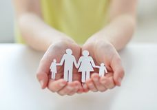 Close up of child hands with paper family cutout Stock Images