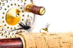 Close up of fly fishing rod and reel on white background Royalty Free Stock Image