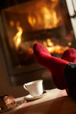 Close Up Of Mans Feet Relaxing By Cosy Log Fire Royalty Free Stock Photos