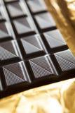 Close Up Of Plain Chocolate Bar On Foil Wrapper Stock Photos
