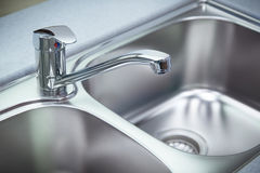 Clean chrome tap and  washbasin Royalty Free Stock Photography