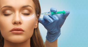 Close up of woman face and hand with syringe Royalty Free Stock Photo