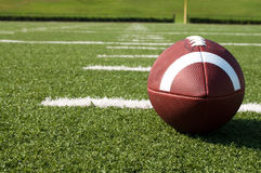 Closeup of American Football on Field Stock Photography