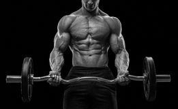 Closeup portrait of a muscular man workout with barbell at gym Royalty Free Stock Images