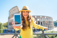 Closeup on woman showing cell phone  in rome Stock Photography