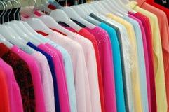 Clothes on shelf Royalty Free Stock Photos