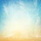 Clouds on a textured vintage paper background Stock Images