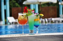 Cocktail at the edge of pool Stock Image