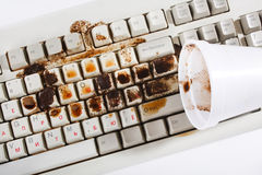 Coffee spilling on keyboard Royalty Free Stock Images