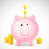 Coin falling into Piggy Bank Royalty Free Stock Photos