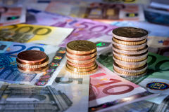 Coins chart on euro banknotes stock exchange, money in rise Royalty Free Stock Photography