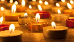 Colored candles lighted Stock Photos