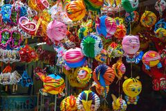 Colorful scene, friendly vendor on Hang Ma lantern street, lantern at open air market, traditional culture on mid autumn, Vietnam, Royalty Free Stock Image