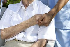 Comfort and Support from a care giver towards the Elderly Royalty Free Stock Image