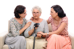 Comforting injured old person Stock Photo