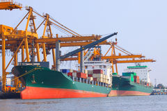 Commercial ship with container on shipping port for import expor Stock Photography