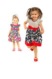 Competition of sisters running Royalty Free Stock Photo