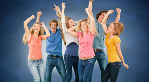 Composite image of friends partying together while laughing and smiling Stock Image