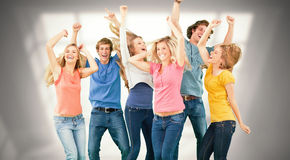 Composite image of friends partying together while laughing and smiling Stock Photos