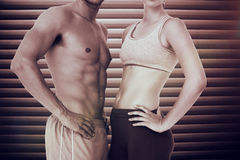 Composite image of mid section of a fit young couple Stock Image
