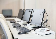 Computers With Headphones At Workplace Royalty Free Stock Images