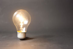 Concept of bright idea with light bulb Royalty Free Stock Image