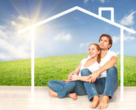 Concept:  housing and mortgage for young families. couple dreaming of  home Stock Image