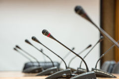 Before a conference, the microphones in front of empty chairs.Se Stock Image