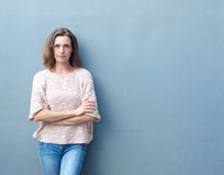 Confident mid adult woman posing with arms crossed Stock Photos