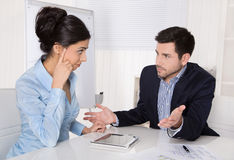 Conflict and problems on workplace: discussing boss and trainee. Stock Photography