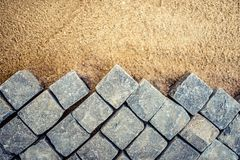 Construction of pavement details, cobblestone pavement, stone blocks on road building Royalty Free Stock Photo