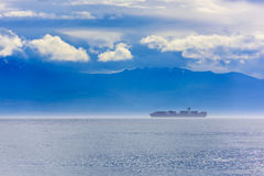 Container ship in the fog Stock Photo
