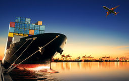 Container ship in import,export port against beautiful morning l Royalty Free Stock Photography