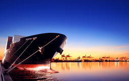 Container ship in import,export port against beautiful morning l Stock Image