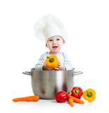 Cook baby inside big pan with healthy food Royalty Free Stock Image