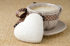 Cookie with icing in the form of heart and a cup of coffee close Stock Images