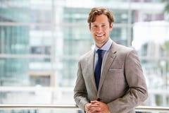 Corporate businessman in modern interior, waist up portrait Royalty Free Stock Photo