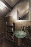 Cosy beige bathroom Stock Photos